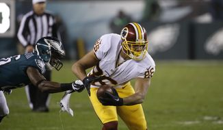 Washington Redskins' Jordan Reed, right, tries to break a tackle by Philadelphia Eagles' Walter Thurmond in the second half of an NFL football game, Saturday, Dec. 26, 2015, in Philadelphia.  (AP Photo/Matt Rourke)