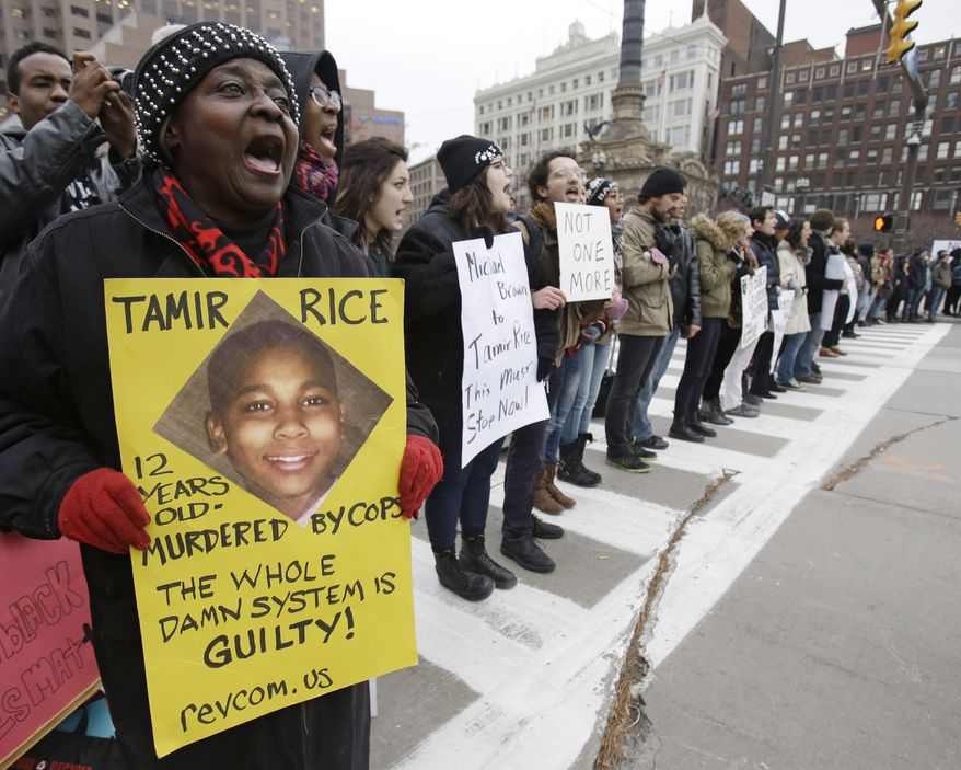 FILE - This Nov. 25, 2014, file photo, shows demonstrators blocking Public Square in Cleveland, during a protest over the police shooting of 12-year-old Tamir Rice. A decision on whether to charge two white officers in the death of Tamir Rice, one of the higher-profile cases of black deaths at the hands of officers that have roiled cities nationwide, could come any day. The grand jury making the decision has been meeting since mid-October. (AP Photo/Tony Dejak, File)