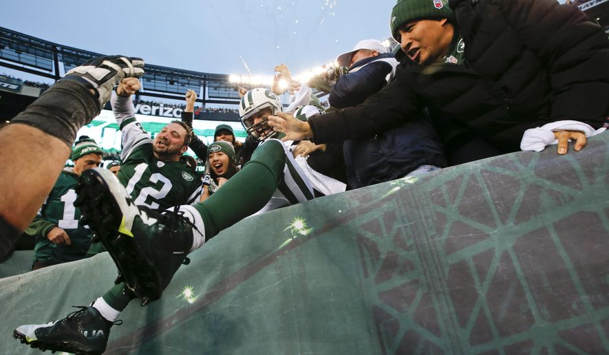 New York Jets wide receiver Eric Decker (87) celebrates with fans after making a touchdown catch to win during the overtime period of an NFL football game against the New England Patriots, Sunday, Dec. 27, 2015, in East Rutherford, N.J. The Jets won 26-20. (AP Photo/Kathy Willens)