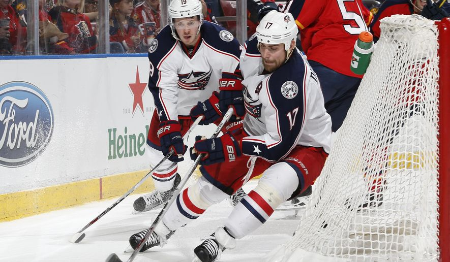 Columbus Blue Jackets center Brandon Dubinsky (17) attempts to wrap the puck around the post during the second period of an NHL hockey game against the Florida Panthers, Sunday, Dec. 27, 2015, in Sunrise, Fla. (AP Photo/Joel Auerbach)