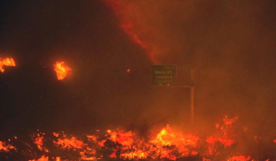 In this photo provided by Diego Topete, fire overruns the state Highway 101 near Ventura, Calif., Saturday, Dec. 26, 2015. The wind-whipped wildfire closed a major coastal highway in Southern California and forced dozens of homes to be evacuated, authorities said Saturday. (Diego Topete via AP)
