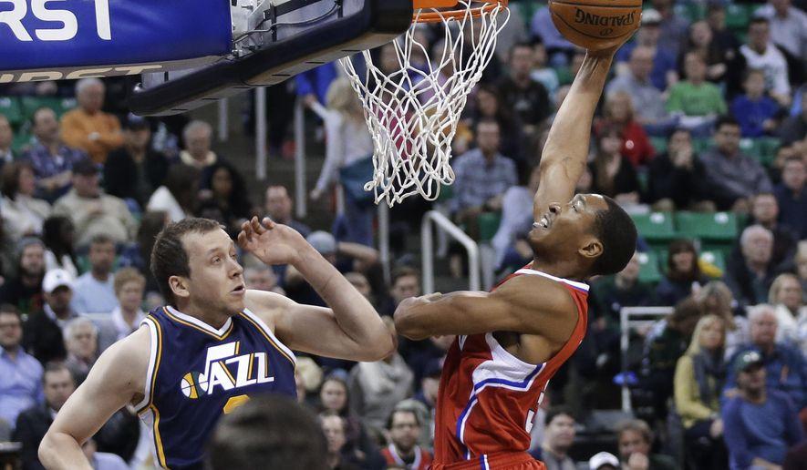 Los Angeles Clippers forward Wesley Johnson (33) goes to the basket as Utah Jazz forward Joe Ingles waetches during the second quarter of an NBA basketball game Saturday, Dec. 26, 2015, in Salt Lake City. (AP Photo/Rick Bowmer)