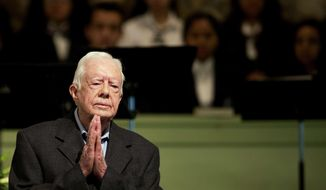 In a Sunday, Aug. 23, 2015 file photo, former President Jimmy Carter teaches Sunday School class at Maranatha Baptist Church in his hometown, in Plains, Ga. Carter's battle with cancer, which put a spotlight on his faith and led to an outpouring of support, is among the state's top stories of 2015. (AP Photo/David Goldman, File)