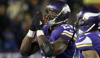 Minnesota Vikings running back Adrian Peterson, left, gestures after his touchdown during the second half of an NFL football game against the New York Giants, Sunday, Dec. 27, 2015, in Minneapolis. (AP Photo/Ann Heisenfelt)