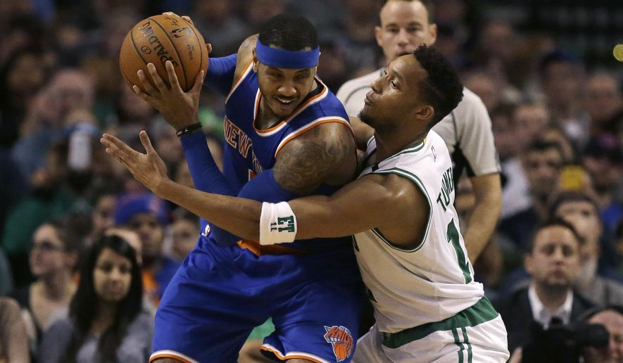 New York Knicks forward Carmelo Anthony, left, looks for an opening around Boston Celtics guard Evan Turner, right, in the second quarter of an NBA basketball game Sunday, Dec. 27, 2015, in Boston. (AP Photo/Steven Senne)