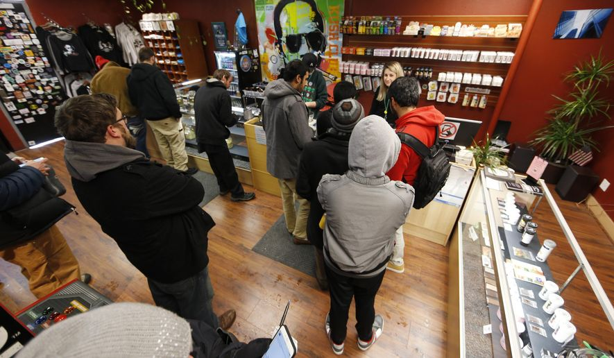 In this file photograph taken Friday, Nov. 27, 2015, buyers queue up at a counter in the Denver Kush Club in north Denver. (AP Photo/David Zalubowski)