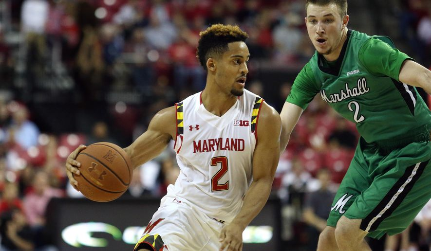 Maryland guard Melo Trimble, left, drives the ball against Marshall guard Stevie Browning, right, in the first half of an NCAA college basketball game, Sunday, Dec. 27, 2015, in College Park, Md. (AP Photo/Matt Hazlett)