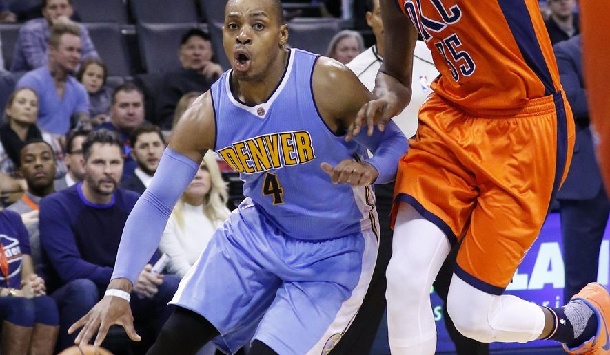 Denver Nuggets guard Randy Foye (4) drives to the basket around Oklahoma City Thunder forward Kevin Durant (35) during the second quarter of an NBA basketball game in Oklahoma City, Sunday, Dec. 27, 2015. (AP Photo/Alonzo Adams)