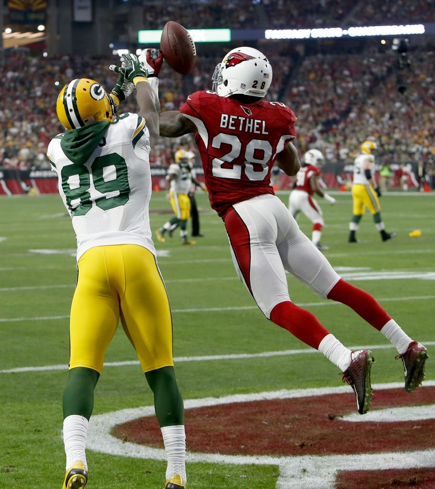 Arizona Cardinals cornerback Justin Bethel (28) intercepts a pass intended for Green Bay Packers wide receiver James Jones (89) in the end zone during the first half of an NFL football game, Sunday, Dec. 27, 2015, in Glendale, Ariz. (AP Photo/Rick Scuteri)