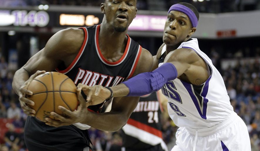 Sacramento Kings guard Rajon Rondo, right, tries to steal the ball from Portland Trail Blazers forward Noah Vonleh, left, during the first quarter of an NBA basketball game in Sacramento, Calif., Sunday, Dec. 27, 2015.AP Photo/Rich Pedroncelli)