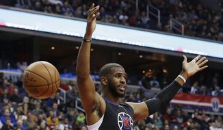 Los Angeles Clippers guard Chris Paul reacts after dunking the ball during the first half of an NBA basketball game against the Washington Wizards, Monday, Dec. 28, 2015, in Washington. (AP Photo/Carolyn Kaster)