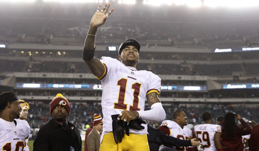 Washington Redskins' DeSean Jackson waves to the stands during the second half of an NFL football game against the Philadelphia Eagles, Saturday, Dec. 26, 2015, in Philadelphia. Washington won 38-24. (AP Photo/Matt Rourke)