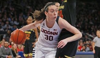 Connecticut forward Breanna Stewart (30) derives around Maryland guard Ieshia Small during the first half of an NCAA college basketball game at Madison Square Garden in New York, Monday, Dec. 28, 2015. (AP Photo/Kathy Willens)