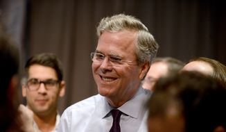 Republican presidential candidate Jeb Bush talks with an attendee at the Forum Club of the Palm Beaches on Monday, Dec. 28, 2015, in West Palm Beach, Fla. (Maria Lorenzino/South Florida Sun-Sentinel via AP) ** FILE **