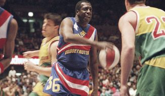 "FILE - In this Feb. 13, 1993, file photo, legendary Harlem Globetrotters' Meadowlark Lemon prepares to put the moves on Washington Generals' Tim Burkhart during their basketball game at Madison Square Garden in New York. Lemon, known as the Globetrotters' ""clown prince"" of basketball, died Sunday, Dec. 27, 2015, in Scottsdale, Ariz. He was 83. (AP Photo/Bebeto Matthews, File)"