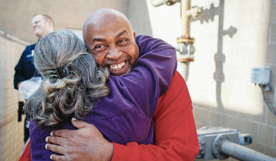 In this Thursday, Dec. 24, 2015 photo, William Virgil is embraced after being released on bond outside the Campbell County Detention Center in Newport, Ky. A Kentucky judge has granted a retrial for Virgil, charged in 1987 with the murder of Retha Welch. A 2010 investigation showed DNA evidence, including hair and blood, was not connected to Virgil or the victim. (Madison Schmidt/The Cincinnati Enquirer via AP)  MANDATORY CREDIT