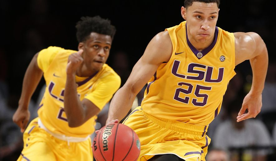 FILE - In this Nov. 24, 2015, file photo, LSU forward Ben Simmons (25) drives downcourt as teammate Antonio Blakeney (2) follows in the first half of an NCAA college basketball game against North Carolina State in New York. For all of his gaudy numbers, Simmons is still trying to figure out the best way to put the Tigers in position to win. And now the schedule gets harder, starting with Tuesday night's, Dec. 29, 2015, tilt against Wake Forest, followed by the opening of Southeastern Conference play against Vanderbilt and No. 10 Kentucky. (AP Photo/Kathy Willens, File)