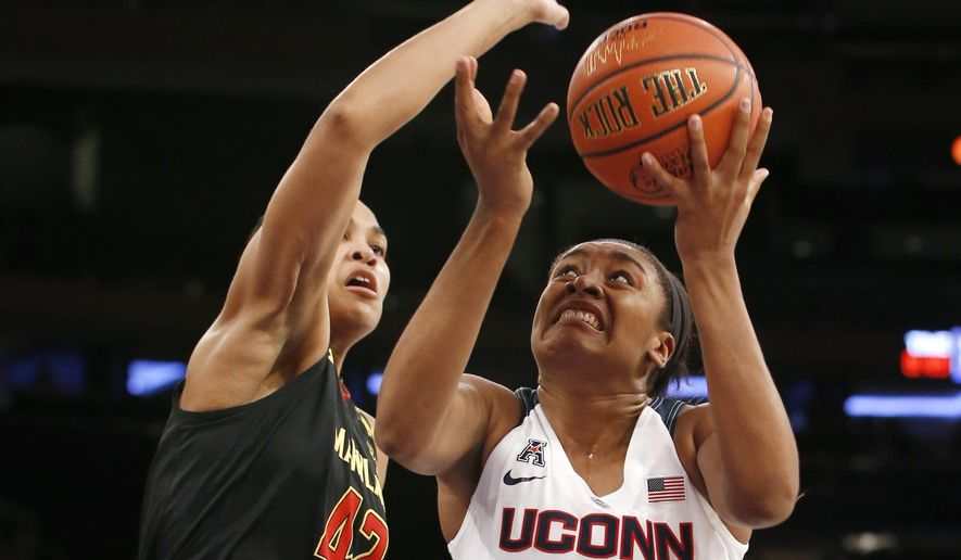 Maryland center Brionna Jones (42) defends Connecticut forward Morgan Tuck (3) during the first half of an NCAA college basketball game at Madison Square Garden in New York, Monday, Dec. 28, 2015. (AP Photo/Kathy Willens)