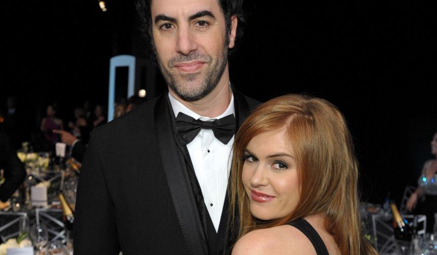 FILE - In a Sunday Jan. 27, 2013 file photo, Sacha Baron Cohen, left, and his wife Isla Fisher pose in the audience at the 19th Annual Screen Actors Guild Awards at the Shrine Auditorium in Los Angeles. Actors Sacha Baron Cohen and his wife Isla Fisher are donating $1 million to Save the Children and the International Rescue Committee to support victims of the conflict in Syria. Save the Children has announced that one-half of the sum will fund a program vaccinating more than 250,000 children against a potential measles outbreak in Northern Syria. The other half of the donation will go toward supporting families, with a special concern for women and children, both inside Syria and in neighboring countries. That money will go toward education, health care, shelter and sanitation, Save the Children said.  (Photo by John Shearer/Invision/AP, File)