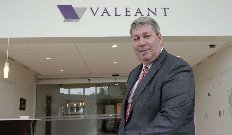 In this Tuesday, May 19, 2015, file photo, Valeant Pharmaceuticals CEO J. Michael Pearson poses at the company's annual general meeting in Montreal. (Ryan Remiorz/The Canadian Press via AP, File)