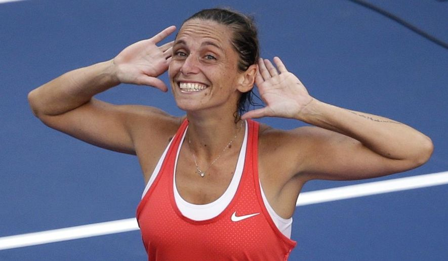 FILE - In this Sept. 11, 2015, file photo, Roberta Vinci, of Italy, reacts to the crowd after defeating Serena Williams in a semifinal at the U.S. Open tennis tournament in New York. (AP Photo/Seth Wenig, File)