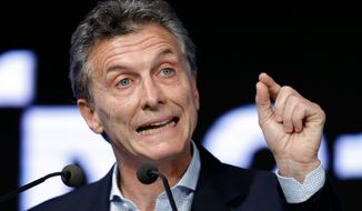 After a chaotic transition that culminated in the outgoing president's refusal to attend her successor's inauguration, Argentine President Mauricio Macri took pains to differentiate his style from the abrasiveness that characterized that of his predecessor, Cristina Fernandez. (Associated Press)