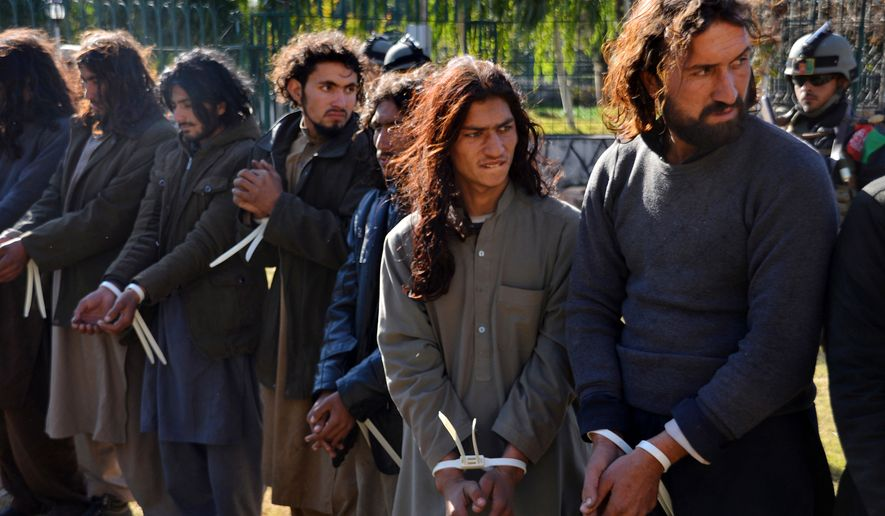 Taliban fighters are handcuffed by Afghan security forces in Jalalabad, capital of Nangarhar province, Afghanistan, Tuesday, Dec. 29, 2015. (AP Photos/Mohammad Anwar Danishyar)