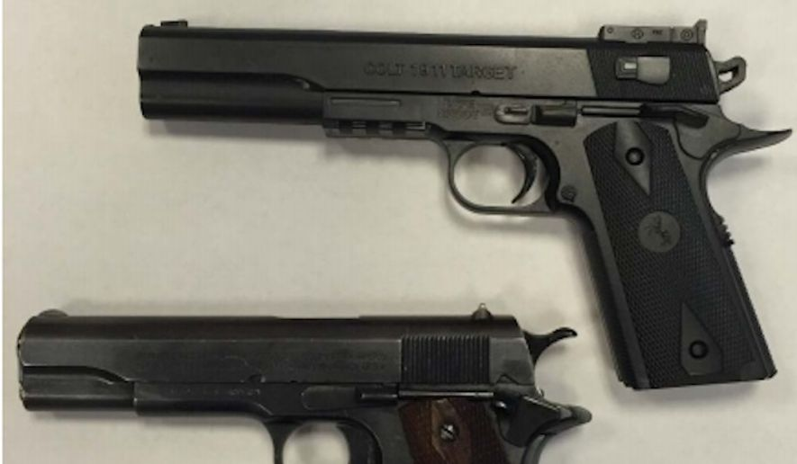 The toy pellet gun (top right) used by 12-year-old Tamir Rice when he was shot and killed by police in Cleveland in Nov. 2014 is pictured beside a real gun. (Image: Cuyahoga County Prosecutor's Office)