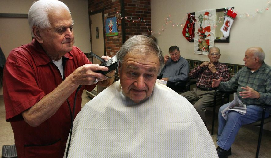 In this Dec. 21, 2015, photo, Tony Manzi cuts hair at Manzi's Barber Shop in Cranston, R.I. The 90-year-old Rhode Island barber is putting down his clippers after 68 years. Manzi has cut five generations of hair at the shop. (Bob Breidenbach/Providence Journal via AP) NO SALES; MANDATORY CREDIT