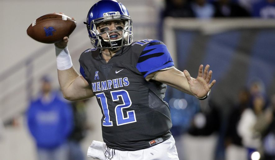 FILE - In this Nov. 7, 2015, file photo, Memphis quarterback Paxton Lynch (12) passes against Navy in the first half of an NCAA college football game in Memphis, Tenn. Memphis (9-3) and Lynch are aiming for another win over a Southeastern Conference team on Wednesday, Dec. 30, in the Birmingham Bowl against Auburn. (AP Photo/Mark Humphrey, File)