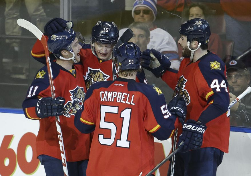 Florida Panthers center Aleksander Barkov (16) is congratulated by center Jonathan Huberdeau (11), defenseman Brian Campbell (51) and defenseman Erik Gudbranson (44) after scoring a goal during the third period of an NHL hockey game against the Montreal Canadiens, Tuesday, Dec. 29, 2015, in Sunrise, Fla. The Panthers defeated the Canadiens 3-1. (AP Photo/Lynne Sladky)
