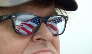 "This image provided by Dog Eat Dog Films shows director Michael Moore in a scene from his documentary, ""Where to Invade Next."" The movie opens in U.S. theaters on Feb. 12, 2016. (Dog Eat Dog Films via AP) ** FILE **"