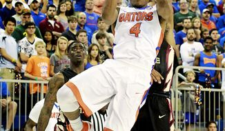 Florida guard KeVaughn Allen (4) takes a shot against the Florida State during the first half of an NCAA college basketball game Tuesday, Dec. 29, 2015, in Gainesville, Fla. (Matt StameyThe Gainesville Sun via AP)