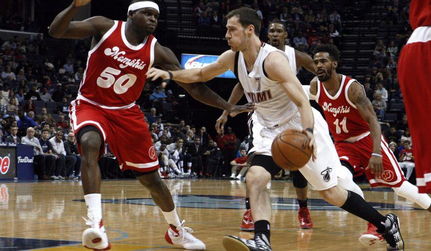 Memphis Grizzlies' Zach Randolph (50) defends Miami Heat's Goran Dragic (7) during the first half of an NBA basketball game Tuesday, Dec. 29, 2015, in Memphis, Tenn. (AP Photo/Karen Pulfer Focht)
