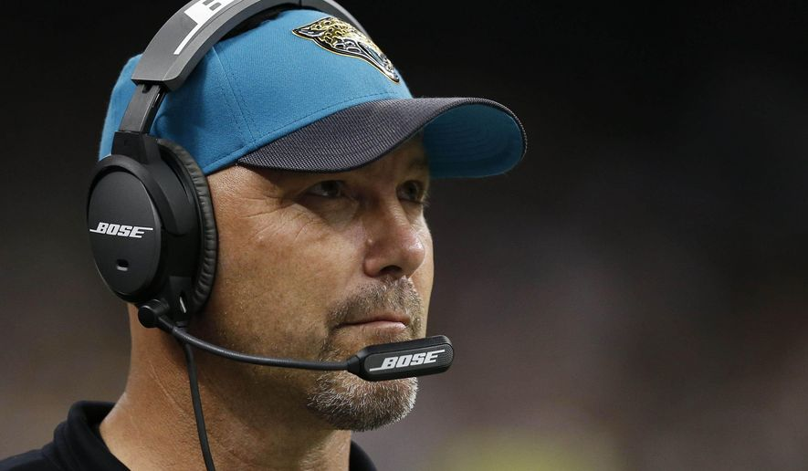 FILE - In this Sunday, Dec. 27, 2015 file photo, Jacksonville Jaguars head coach Gus Bradley works the sideline in the second half of an NFL football game against the New Orleans Saints in New Orleans. Jacksonville Jaguars coach Gus Bradley will return in 2016. Jaguars owner Shad Khan has released a statement confirming that Bradley will remain in place for the final year of his contract, Tuesday, Dec. 29, 2015 (AP Photo/Rogelio Solis, File)
