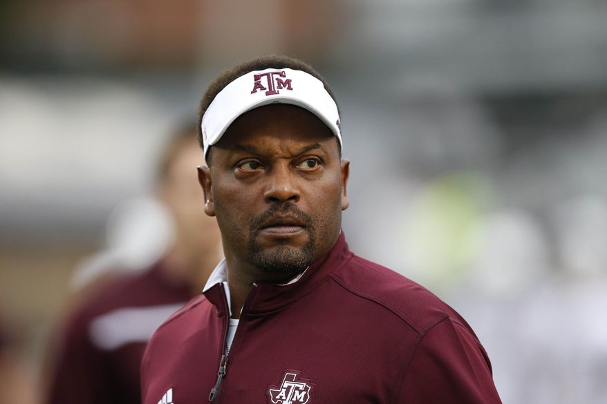 FILE - In this Saturday, Oct. 24, 2015 file photo, Texas A&M head coach Kevin Sumlin looks at the score board prior to their NCAA college football game against Mississippi in Oxford, Miss. Texas A&M coach Kevin Sumlin goes into the Music City Bowl down to his third option at quarterback with Kyle Allen and Kyler Murray deciding to transfer away from the Aggies.  (AP Photo/Rogelio V. Solis, File)