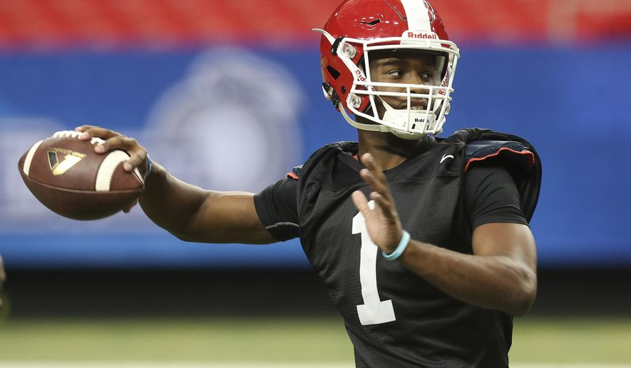 Houston quarterback Greg Ward Jr. (1) throws during a practice for the Peach Bowl football game at the Georgia Dome Tuesday, Dec. 29, 2015, in Atlanta. Houston will play Florida State on New Year's Eve.(AP Photo/John Bazemore)
