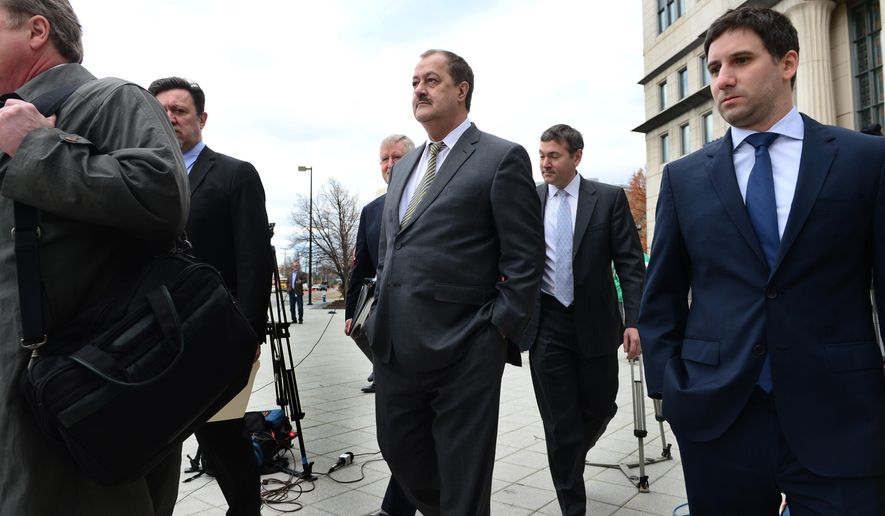 FILE - In this Thursday Dec. 3, 2013, file photo, Don Blankenship, center, leaves the federal courthouse with his attorneys after the verdict in his trial in Charleston, W.Va. The former Massey Energy CEO was convicted of a misdemeanor count connected to a deadly coal mine explosion and acquitted of more serious charges. A federal jury in West Virginia convicted Blankenship of conspiring to willfully violate mine safety standards. The misdemeanor charge carries up to one year in prison. He was acquitted of a more serious conspiracy charge that could have netted five years in prison. He was also acquitted of making false statements and securities fraud. (Kenny Kemp/Charleston Gazette via AP, File) MANDATORY CREDIT