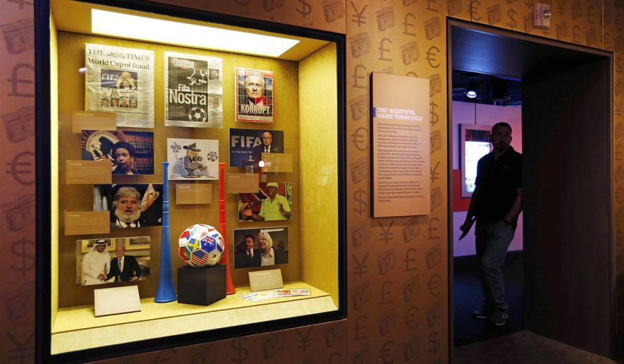 """FILE - In this Tuesday, Sept. 1, 2015, file photo, Items on FIFA corruption are on display at the Mob Museum in Las Vegas. The display is titled """"The 'Beautiful Game' Turns Ugly"""". All across Europe and the Americas as they plot legal strategy, await extradition hearings and consider the billable hours run up by their lawyers, FIFA officials can take comfort in this: They are serving the cause of art. (AP Photo/John Locher, File)"""