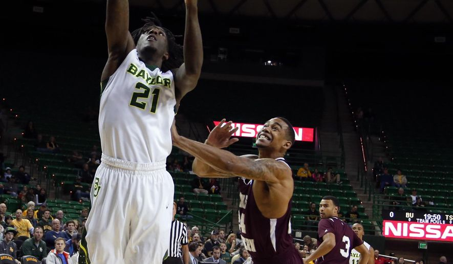 Baylor forward Taurean Prince (21) scores over Texas Southern forward Orlando Coleman, right, in the first half of an NCAA college basketball game, Tuesday, Dec. 29, 2015, in Waco, Texas. (AP Photo/Rod Aydelotte)