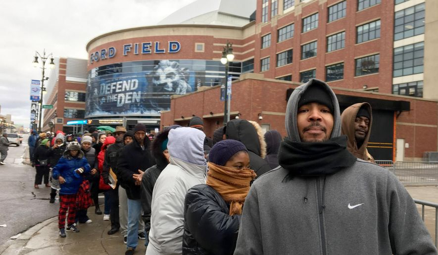 """Rashad Morgan, 31, waits in line in Detroit Tuesday, Dec. 29, 2015, to resolve tickets free of $200-$300 in late fees at 36th District Court's """"2-Day Holiday Sales Event"""" in Detroit. The crowds were for the final day of the event, which was scheduled to end Tuesday afternoon at 36th District Court downtown. (Robert Allen/Detroit Free Press via AP)"""