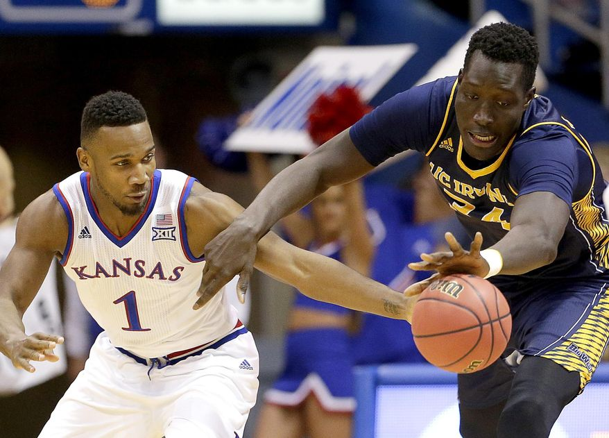Kansas' Wayne Selden Jr. (1) and UC Irvine's Mamadou Ndiaye (34) chase a loose ball during the first half of an NCAA college basketball game Tuesday, Dec. 29, 2015, in Lawrence, Kan. (AP Photo/Charlie Riedel)