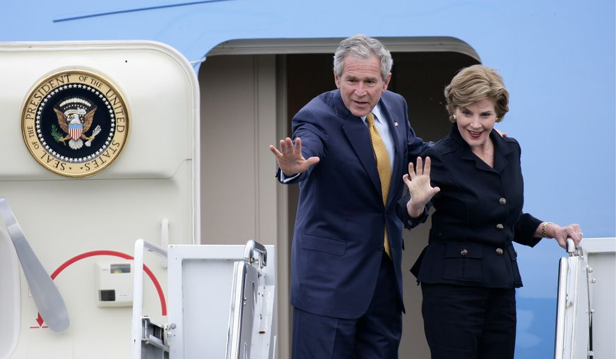 U.S. President George W. Bush and first lady Laura Bush wave as they board Air Force One to depart from RAF Aldergrove in Belfast, Northern Ireland, Monday, June 16, 2008. (AP Photo/Michael Cooper)