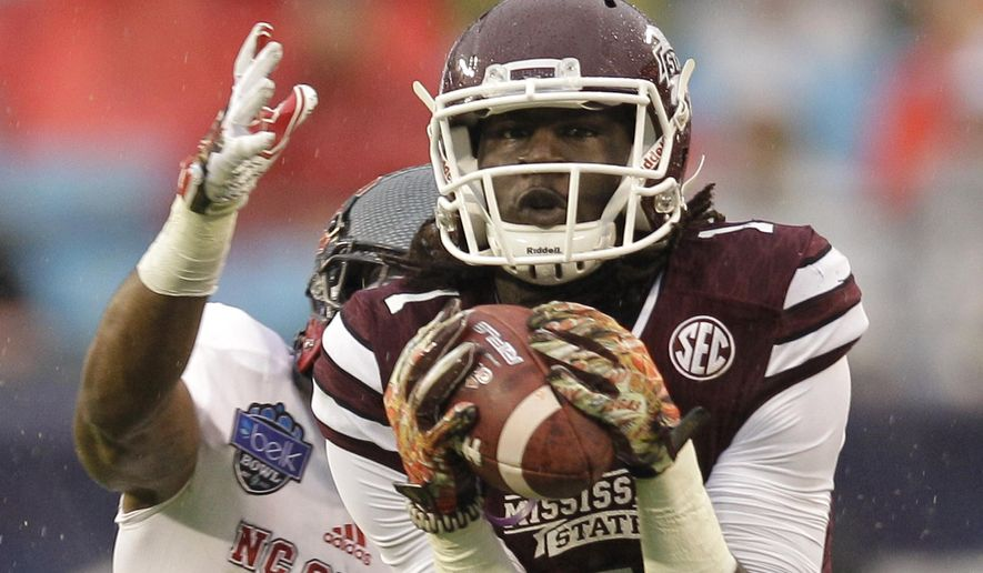 Mississippi State wide receiver De'Runnya Wilson (1) catches a pass as North Carolina State cornerback Juston Burris (11) defends in the first half of the Belk Bowl NCAA college football game in Charlotte, N.C., Wednesday, Dec. 30, 2015. (AP Photo/Nell Redmond)