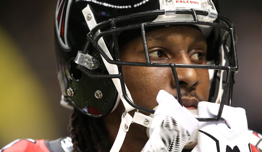 FILE - In this Oct. 15, 2015, file photo, Atlanta Falcons wide receiver Roddy White warms up before an NFL football game against the New Orleans Saints in New Orleans. White is not having a typical year for him when it comes to production as the Falcons try to finish the season with a winning record for the first time since 2012. (AP Photo/John Bazemore, File)