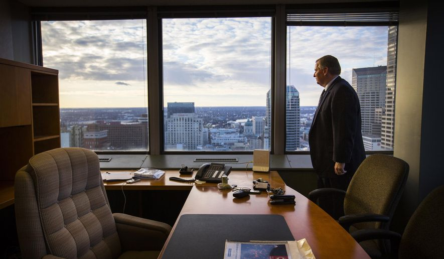 In this Dec. 18, 2015 photo, Indianapolis Mayor Greg Ballard poses for a portrait inside his office inside in Indianapolis.  Ballard is ending eight years as Indianapolis mayor, capping a period during which he oversaw the city's hosting of the 2012 Super Bowl while also struggling with persistent violent crime problems. (Mykal McEldowney/The Star via AP)