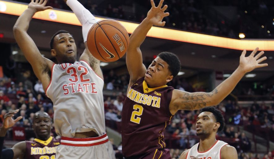 Minnesota's Nate Mason, right, loses control of the ball while driving to the basket against Ohio State's Trevor Thompson during the first half of an NCAA college basketball game, Wednesday, Dec. 30, 2015, in Columbus, Ohio. (AP Photo/Jay LaPrete)