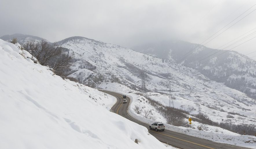 Vehicles travel on North Ogden Canyon Road in the North Ogden Divide, Utah, Tuesday, Dec. 29, 2015. Sarah Crenshaw was edging along the familiar mountain road in Utah when her SUV hit a patch of black ice and slid over a precipice. Crenshaw, 48, survived the 320-foot tumble into a ravine on the morning of Dec. 20, escaping with only minor injuries. (Briana Scroggins/Standard-Examiner via AP) MANDATORY CREDIT