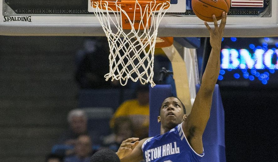 Seton Hall's Desi Rodriguez shoots against Marquette during the first half of an NCAA college basketball game Wednesday, Dec. 30, 2015, in Milwaukee. (AP Photo/Tom Lynn)
