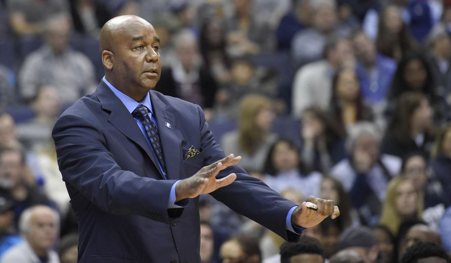 FILE - In this Saturday, Dec. 5, 2015 file photo, Georgetown head coach John Thompson III gestures during the first half of an NCAA college basketball game against Syracuse in Washington. After a conscious effort to test a team that relies heavily on freshmen and sophomores, coach John Thompson III's Georgetown heads into Big East play with five non-conference losses for just the second time in program history.(AP Photo/Nick Wass, File)